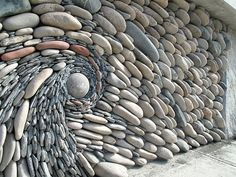 The Ancient Art of Stone: Couple Creates Beautiful Rock Wall Art Installations | Andreas Kunert and Naomi Zettl, a married artist duo based in Vancouver, create beautiful flowing wall installations out of rocks, pebbles, and other decorative elements.