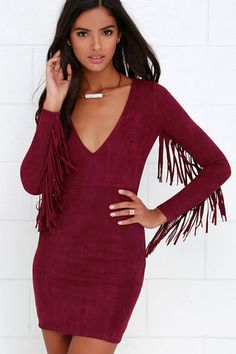 If you have a fashion sense that just can't be tamed, you'll love the Still Wild Burgundy Suede Fringe Dress! Soft, vegan microfiber suede flows from a V neckline into a darted bodice, while long, fitted sleeves boast fringe all along the bottom seam. Sheath skirt will wow as it gently glides along your curves. Hidden back zipper with clasp.