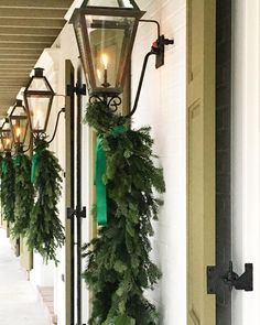 Ribbons, garland, and beautiful gas lanterns. This was a favorite moment from last weeks holiday installation. Wall Lights, Gas Lanterns, Holiday, Candle Sconces, Lanterns, Ladder Decor, Lantern Christmas Decor, Light, Merry Christmas To You