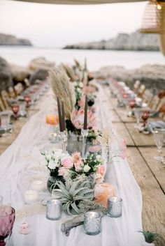 Boho Beach Wedding In Greece Rhodes Destination wedding beach reception table decoration airplans silver pink centerpiece decor