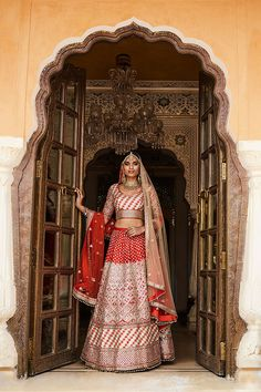 Jhalak ( A Glistening Sunset ) Flaming orange lehenga set with a gota patti kufahl pattern.