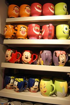 I'm in HEAVEN!!! Disney mugs - the mug shelf at the Disney store always excites me! :)