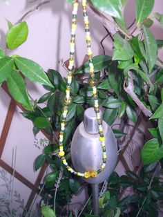 neckless with 2 big pearls and small ones, colours green, white and yellow