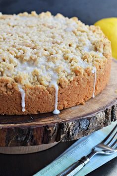 Lemon Crumb Cake with a creamy lemon cheesecake filling! Perfect for holidays or brunch! Can't wait to try this dessert recipe!