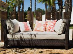 Sofa de rattan sintético con cojines