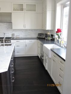 I have honed black labrador and polished statuary marble. Because of the stone, the honed black labrador has a texture to it which is a lot like leathered. I love it - it is basically bullet proof. And, it offers a great compliment to my marble. I have a stacked statuary marble back splash behind the black labrador which sort of ties it all together.
