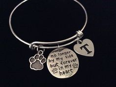 Meaningful Memorial to a Lost Pet. No Longer in My Heart but Forever in My Heart with Initial and Paw Print Charm securely attached to a Silver Plated Expandable Bracelet. Please let me know what Init