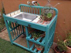 Repurpose a crib into a potting bench