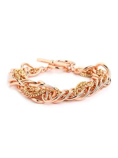 How do you up your ladies who lunch?  Take the classic chain-link bracelet, infuse downtown, haphazard cool and finish it off in the metal of the moment: rose gold. The sweetest finishing touch? A delicate toggle clasp.
