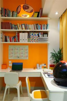 Love the bright color for a functional office! dhomeinteriordesign.com