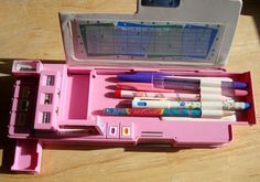 A push button pencil case - I freaking loved these things...got 2 for my 11th birthday. All the compartments were awesome!!!