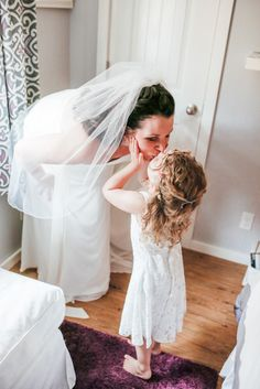 Love this sweet picture of the bride and her fower girl. Photography by Victoria Greener.  See more here...www.intimateweddings/blog/real-weddings #flowergirl