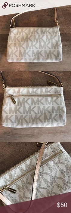 Michael Kors Clutch This bag is practically brand new ! I used a couple times MICHAEL Michael Kors Bags Clutches & Wristlets