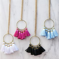 Gold circles adorned with colorful tassels! #yesplease #welovetassels #madisonraleigh