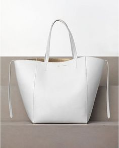 The best red, white, and blue handbags for the of July. Very cute white Celine Cabas Leather Handbags Uk, Blue Handbags, Purses And Handbags, Leather Bags, Tote Bags, Celine Tote, Fab Bag, Bags Online Shopping, Hugo Boss