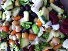 Raw Veggie and Bean Salad!  Raw veggies (broccoli, cauliflower, zucchini and carrots) chopped and diced. Add a mix of beans (kidney, black and chickpeas). Toss with some olive oil and lemon. Add pepper and thyme to taste.
