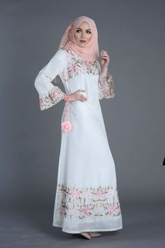 This white Maxi Dress is delicately embellished with azalea pink flowers, making it stunning for the summer!  #Fashion! #womenclothe, #onlineshopping, #modestfashion, #onlinefashion, #hijabfashion, #hijabfashionista, #hijabstyle, #hijabiqueen, #floraldres