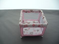 Miniature playpen in Pink turtle fabric 1/12th scale. £15.00, via Etsy.