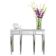 Mirrored+console+table+with+tapered+legs.+  Product:+Console+tableConstruction+Material:+Mirrored+glass