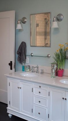 Bathroom with white vanity and aqua walls - paint colors: Sherwin Williams #SW6477 Tidewater & Trim #SW7004 Snowbound - Mirrors from Restoration Hardware, lights from Rejuvenation Lighting, glass shelves from Target