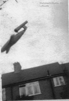 """Nazi """"buzz bomb"""" or V rocket about to hit a UK target, assume London."""