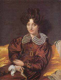 Madame Marie Marcotte wears a brown gown with a wide buckled belt, full sleeves, and a sheer collar with shell buttons. Her hair is worn in elaborate curls on the sides and on top. 1826. - portrait by Ingres