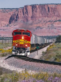 Navajoland <br> With towering mesas of red sandstone as a backdrop and Purple Aster and Chamisa adding seasonal color, Santa Fe 140 leads the east at MP at North Guam in scenic western New Mexico on September Backpacking Europe, Europe Packing, Traveling Europe, Packing Lists, Travel Packing, Train Car, Train Tracks, Railroad Photography, Nature Photography