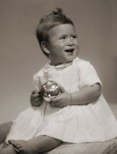 Toddler Prince Charles (Charles Philip Arthur George) (14 Nov 1948-living2015) of Wales, UK seated, looking to his left & holding a silver ball.  1st child of Queen Elizabeth II (Elizabeth Alexandra Mary) (21 Apr 1926-living2015) UK, Adams Studio, by Marcus Adams (1875-1959), 26 Oct 1949.