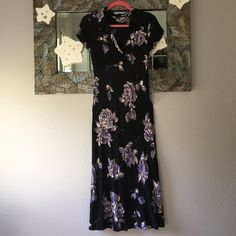 Floral Maxi Black and purple floral maxi! Greta condition except one small tear under the color on the neck but can't even see it because the color folds over! Dresses Maxi