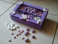 a painted and decorated wood box to be used as confetti, tea bags, jewels holder