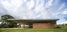Monumental grassy roof covers Planar House in Brazil by Studio MK27