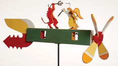 For more than 20 years, Peter Gelker has been creating whirligigs. As a child Gelker – now a physician, psychiatrist and psychoanalyst – watched his father build the spinning objects. Kinetic Toys, Kinetic Art, Lightning Rod, Angel And Devil, Wind Spinners, Wooden Crates, Dremel, Yard Art, Gaming