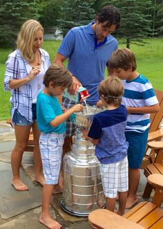 The Cullens eating cereal out of the Stanley Cup.