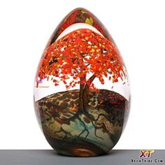 """""""Autumn egg"""" by Cathy Richardson ~ one of her seasonal variations on flowering tree theme. All have three tree trunks spaced around the perimeter of each glass paper weight. Art Of Glass, Kaleidoscopes, Egg Art, Glass Marbles, Glass Paperweights, Glass Ball, Paper Weights, Hand Blown Glass, Colored Glass"""