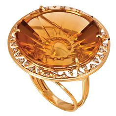 Carved Citrine, gold, and diamond ring by Vianna.