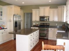 "Ellen Kennon ""Edgewood Green"" (gray countertops, white cabinets, green walls)"