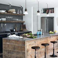 Reclaimed materials are bang on trend at the moment but the look needs to be executed properly to keep it crisp and stylish. We're loving the aged planks with the thin stainless steel worktop on this island. www.housetohome.co.uk/articles/how-to-get-that-chic-industrial-look_532604.html
