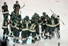 Apr 24, 2014; Saint Paul, MN, USA; Minnesota Wild players celebrate the 2-1 victory over Colorado Avalanche in game four of the first round of the 2014 Stanley Cup Playoffs at Xcel Energy Center. Mandatory Credit: Marilyn Indahl-USA TODAY Sports