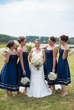 A nautical navy blue and gold wedding in Poquoson, Virginia, captured by Maria Grace Photography.
