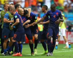 Spain v Netherlands: Group B - 2014 FIFA World Cup Brazil - SALVADOR, BRAZIL - JUNE 13: Arjen Robben of the Netherlands puts his arm around teammate Robin van Persie after van Persie scored their teams first goal during the 2014 FIFA World Cup Brazil Group B match between Spain and Netherlands at Arena Fonte Nova on June 13, 2014 in Salvador, Brazil. (Photo by Paul Gilham/Getty Images)
