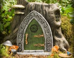 1000 images about trees and castles and wooden doors on for Secret fairy doors by blingderella