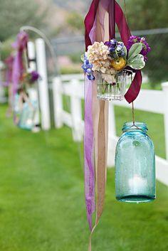 Purple and blue wedding reception flowers