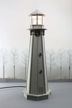 Cardboard Lighthouse Lamp an enchanting bedside by LifeInCardboard $399.00  Height: 54.6 cm or 22.2 inch Width: 18 cm or 7 inch