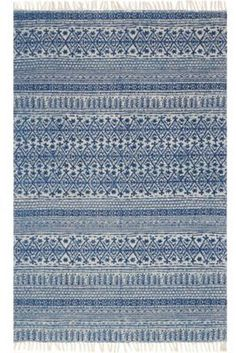 Update your home with a casual, timeless look with the June Rug from Magnolia Home by Joanna Gaines. This durable hand-woven cotton rug has a simple, elegant pattern with a fringed border, perfect for heavy foot traffic areas of your home.