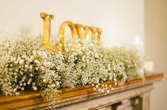 Low Gypsophila top table arrangement idea (minus the sign). Would have this along the table in front of the small birdcages Flower Centerpieces, Flower Decorations, Wedding Centerpieces, Flower Arrangements, Table Arrangements, Centrepieces, Table Decorations, Winter Wedding Flowers, Wedding Colors