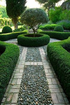 .love the curved hedges and river stones on their sides