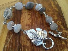Fancy Jasper and Botswana Agate wire wrapped handmade toggle bracelet and earrings. $37.00, via Etsy.