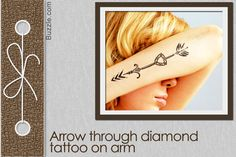 arrow through diamond tattoo on arm