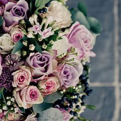 Bridal bouquet of dusky pink roses, steel berries and eucalyptus. Perfect for a winter wedding on a clear, crisp day.