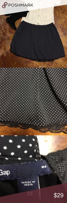 Black skirt with white polka-dots and lace hem💋 Super sweet skirt black with mini polkadots and a black lace detail on the hem. Only worn a couple of times. It is Gap size 20w it has a liner as well. There is no stretch to this fabric. Happy poshing! GAP Skirts Mini